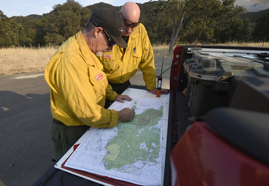 California Incident Team 3 Operation Branch Director Alex McBath and Operation Section Chief Patrick Russel work the Whittier Fire Sunday July 9, 2017