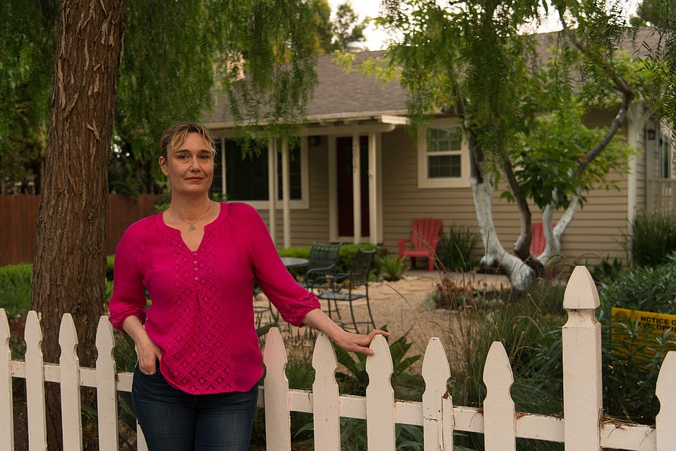 Neighborhood activist Anne Marie Gott has been rallying local residents against short-term vacation rentals like this one she's pictured with.