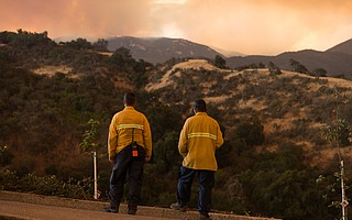 Strike teams of firefighters assigned to devisions across the southern flank of the Whittier Fire prepare to defend homes in the El Capitan Ranch neighborhood off of Calle Real. The community is under a mandatory evacuation order.