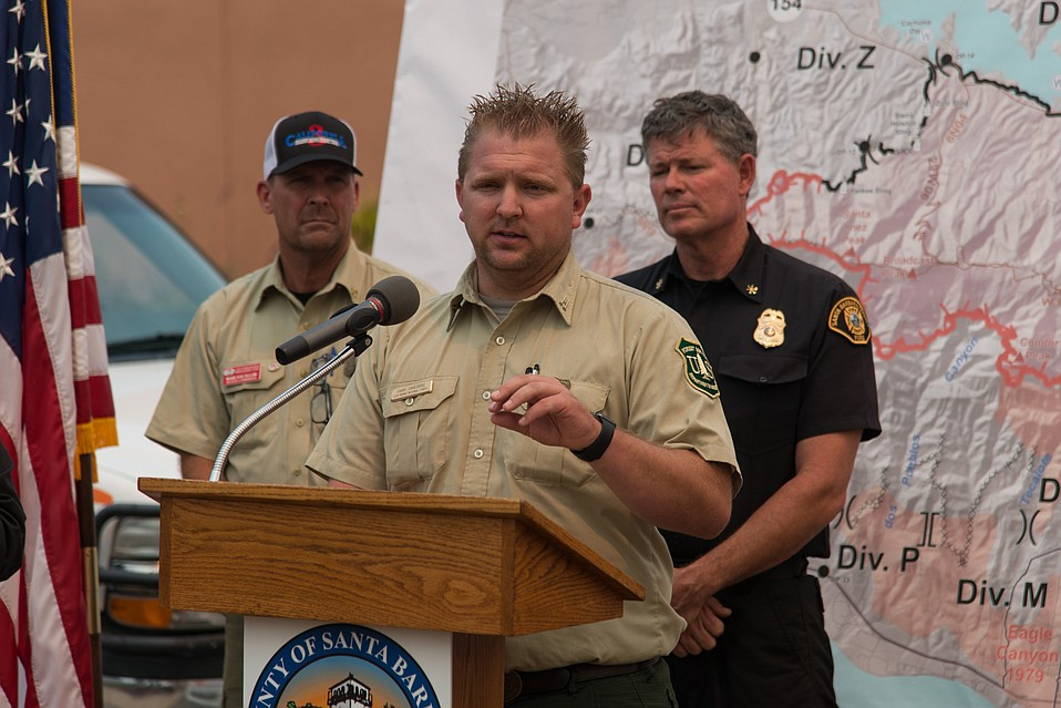 Forest Service patrolman Dave Dahlberg, Fire Division Chief Steve Oaks, and Whittier Fire Incident Commander Mark von Tillow answer questions during a presser about the rescue from Circle V Ranch Camp on Friday.