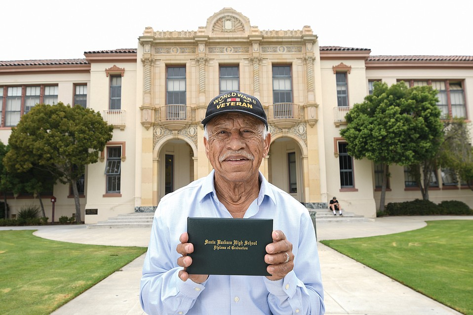 Gilbert Ramirez stands in front of SBHS, where he was scheduled to graduate in 1945.