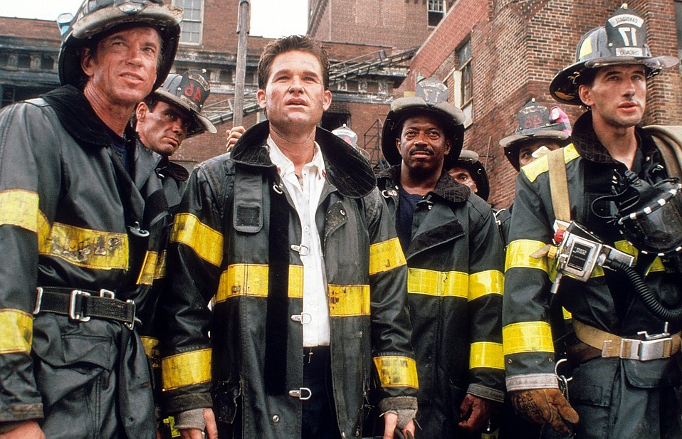 Actor Billy Baldwin (right) and fellow cast members in 'Backdraft.'