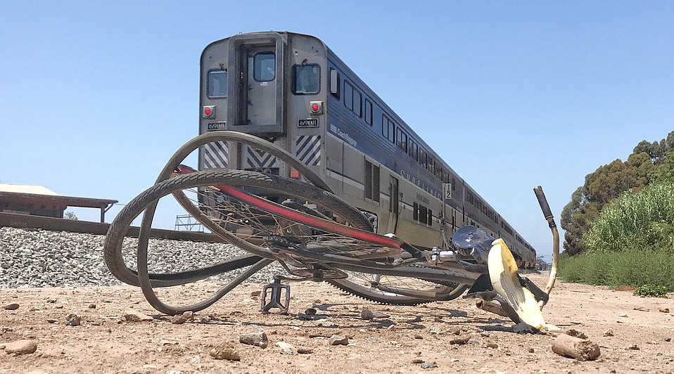 Edmund Backus's bicycle lies beside the tracks where he was killed on Thursday afternoon, struck by a northbound Pacific Surfliner.