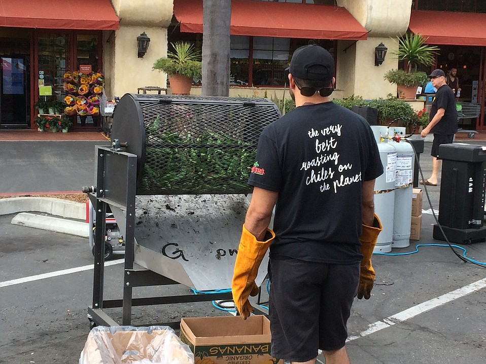 Fresh chiles are a'roasting in Loreto Plaza's parking lot on Saturday.