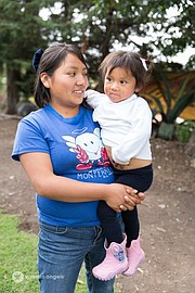"""<strong>Mom:</strong> Yanely Becceril Garcia<strong> Children:</strong> Yanely (2). Spots started to appear on her child's face about a year ago, a tell-tale sign of vitamin A deficiency. The supplements erased the spots. """"It was a huge relief,"""" she said. Yanely is one of the few people we met who enrolled in college in Mexico City after high school. She wanted to study nutrition, but money problems forced her back home. She doesn't miss the city, though, with its traffic and pollution. """"Here it's quiet, and you can see the sky,"""" she said. Yanely said she wants her daughter """"to become someone in life, to be better than me."""""""
