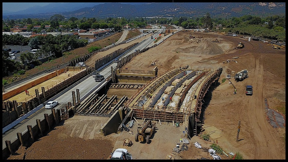 From the air, the ongoing 101 project at Carpinteria Creek and its new Via Real connection: at far right is the southbound 101, northbound at center, Via Real bridge at right.
