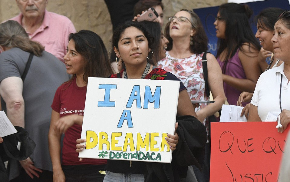 A student holds a sign at a rally in defense of Deferred Action for Childhood Arrivals (DACA) at the Santa Barbara Courthouse