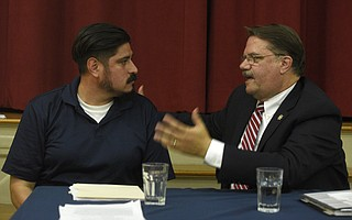 Frank Rodriguez with CAUSE (left) and Sheriff Bill Brown discuss Senate Bill 54 at the Unitarian Society of Santa Barbara town hall meeting.