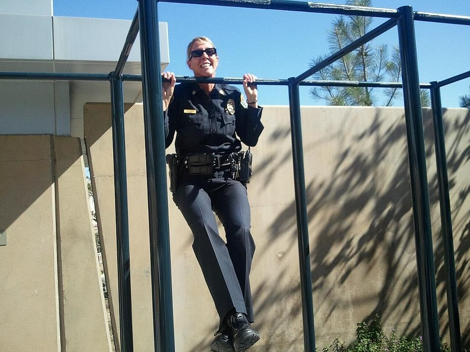 Pull-ups are part of Police Chief Lori Luhnow's fitness routine.