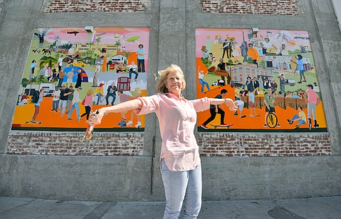 Ruth Ellen Hoag with her funk zone mural.