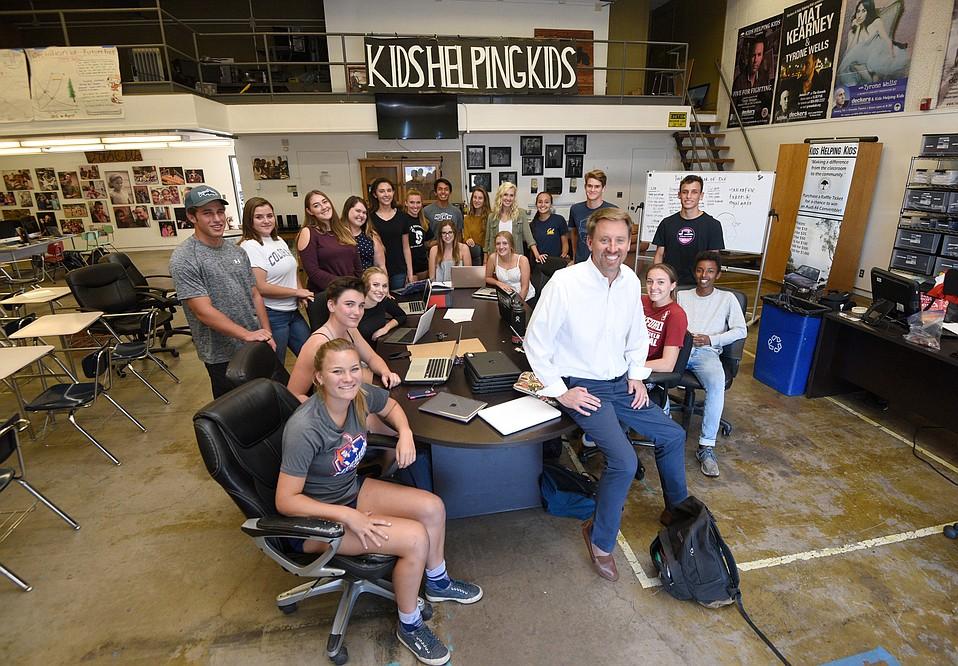 Honoree Jamie DeVries (white shirt) and his student-run Kids Helping Kids crew