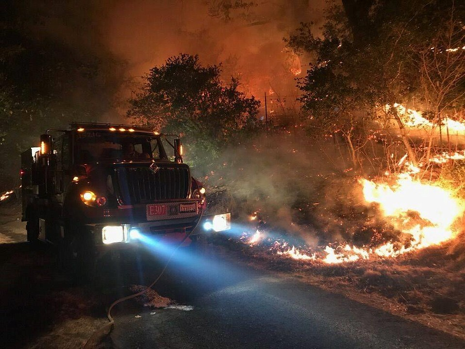 About 70 firefighters from Santa Barbara County fire districts are currently deployed across California, including this S.B. City Fire engine company in Napa.