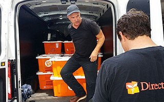 Direct Relief CEO Thomas Tighe loads emergency health kits in Puerto Rico.